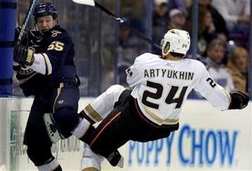 St. Louis Blues' Cam Janssen, left, and Anaheim Ducks' Evgeny Artyukhin, of Russia, get tangled along the boards during the second period of an NHL hockey game Saturday, Jan. 23, 2010, in St. Louis. (AP Photo/Jeff Roberson) By Jeff Roberson