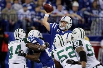 Indianapolis Colts quarterback Peyton Manning (18) gets protection as he passes against the New York Jets during the AFC Championship NFL football game, Sunday, Jan. 24, 2010, in Indianapolis. (AP Photo/Mark Duncan) By Mark Duncan