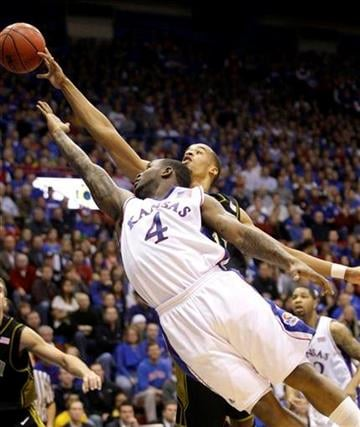 Kansas' Sherron Collins (4) puts up a shot under pressure from Missouri's Laurence Bowers, back, during the first half of an NCAA college basketball game Monday, Jan. 25, 2010, in Lawrence, Kan. (AP Photo/Charlie Riedel) By Charlie Riedel