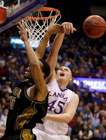Kansas' Cole Aldrich (45) blocks a shot by Missouri's Keith Ramsey during the second half of an NCAA college basketball game Monday, Jan. 25, 2010, in Lawrence, Kan. Kansas won 84-65. (AP Photo/Charlie Riedel) By Charlie Riedel