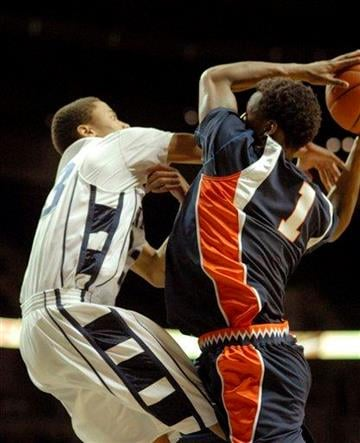 Illinois'  D.J. Richardson draws a foul from Penn State's Tim Frazier in second half of an NCAA college basketball  game in State College, Pa. Wednesday, Jan. 27, 2010. Illinois won 77-67.  (AP Photo/Ralph Wilson) By Ralph Wilson
