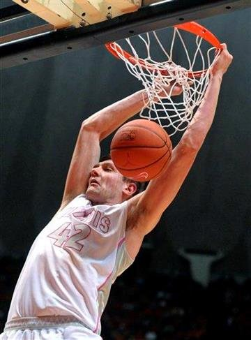 Illinois' Tyler Griffey (42) dunks the ball against Indiana  in the first half of an NCAA college basketball game  in Champaign, Ill. on Saturday, Jan. 30, 2010. (AP Photo/Heather Coit) By Heather Coit