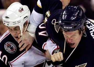 St. Louis Blues' Brad Winchester, right, and Columbus Blue Jackets' Jared Boll, left, fight during the second period of an NHL hockey game Saturday, Jan. 30, 2010, in St. Louis. (AP Photo/Jeff Roberson) By Jeff Roberson