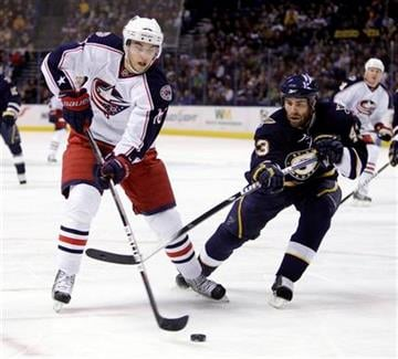 Columbus Blue Jackets' Derick Brassard, left, and St. Louis Blues' Mike Weaver chase after a loose puck during the first period of an NHL hockey game Saturday, Jan. 30, 2010, in St. Louis. (AP Photo/Jeff Roberson) By Jeff Roberson