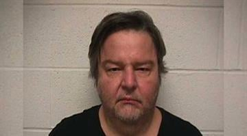 Michael J Pasterski, 57, was charged with aggravated unlawful use of a weapon. By Dan Mueller