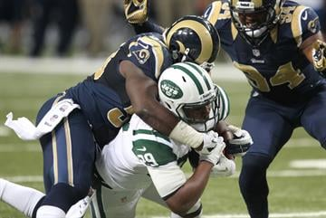 St. Louis Rams Jo-Lonn Dunbar brings down New York Jets Bilai Powell in the fourth quarter at the Edward Jones Dome in St. Louis on November 18, 2012. New York won the game 27-13. UPI/Bill Greenblatt By BILL GREENBLATT