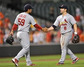 St. Louis Cardinals pitcher Fernando Salas, left, and second baseman Nick Punto celebrate the Cardinals' 6-2 win against the Baltimore Orioles in a baseball game Tuesday, June 28, 2011, in Baltimore.(AP Photo/Gail Burton) By Gail Burton
