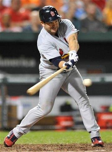 St. Louis Cardinals' Nick Punto swings on a triple against the Baltimore Orioles in the seventh inning of a baseball game Tuesday, June 28, 2011, in Baltimore. The Cardinals won 6-2. (AP Photo/Gail Burton) By Gail Burton