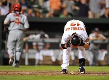 Baltimore Orioles' Mark Reynolds reacts after striking out against the St. Louis Cardinals in the seventh inning of a baseball game Tuesday, June 28, 2011, in Baltimore. The Cardinals won 6-2.(AP Photo/Gail Burton) By Gail Burton