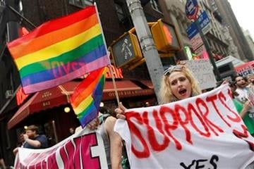 Gay rights advocate Booker Garrett, of Manhattan, chants slogans during a rally for same sex marriage outside the LGBT gala fundraiser where President Barack Obama spoke, Thursday, June 23, 2011 in New York.  (AP Photo/Mary Altaffer) By Mary Altaffer