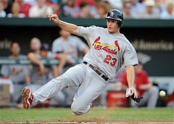St. Louis Cardinals' David Freese comes home to score on a single by Tony Cruz during the second inning of an interleague baseball game against the Baltimore Orioles, Thursday, June 30, 2011, in Baltimore. (AP Photo/Nick Wass) By Nick Wass