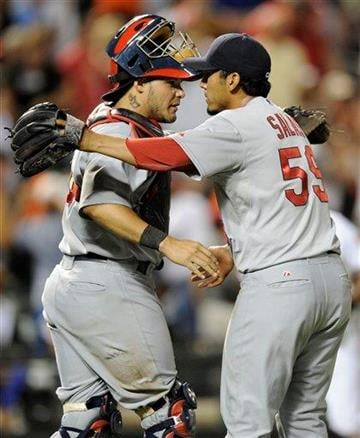 St. Louis Cardinals relief pitcher Fernando Salas (59) celebrates with catcher Yadier Molina after the Cardinals' 9-6 win over the Baltimore Orioles in a baseball game Thursday, June 30, 2011, in Baltimore. (AP Photo/Nick Wass) By Nick Wass