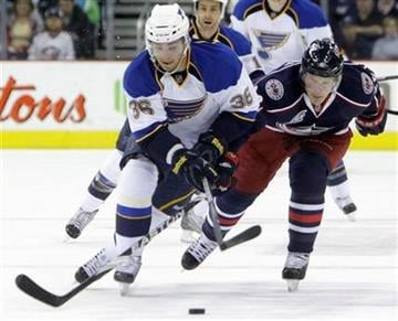 St. Louis Blues' Matt D'Agostini, left, and Columbus Blue Jackets' Samuel Pahlsson, of Sweden, fight for a loose puck during the first period of an NHL hockey game on Wednesday, March 9, 2011, in Columbus, Ohio. (AP Photo/Jay LaPrete) By Jay LaPrete