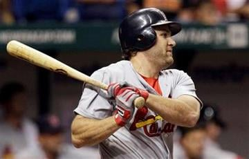 St. Louis Cardinals' Lance Berkman follows through on a second-inning double off Tampa Bay Rays starting pitcher Wade Davis during an interleague baseball game Friday, July 1, 2011 in St. Petersburg, Fla. (AP Photo/Chris O'Meara) By Chris O'Meara
