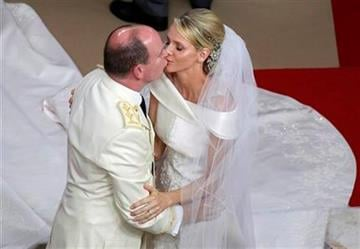 Prince Albert II of Monaco kisses his bride Charlene Princess of Monaco during their religious wedding ceremony at the Monaco palace, Saturday, July 2, 2011. (AP Photo/Pool) By KMOV Web Producer