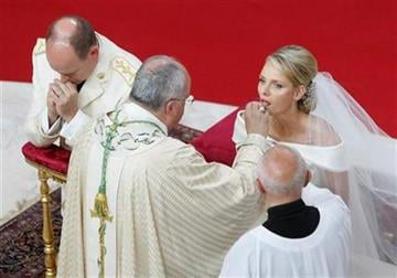 Prince Albert II of Monaco and Charlene Princess of Monaco take holy communion during their religious wedding ceremony at the Monaco palace, Saturday, July 2, 2011.  (AP Photo/Lionel Cironneau, Pool) By Lionel Cironneau
