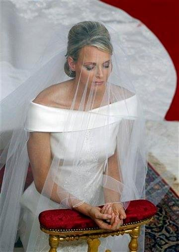 Charlene Princess of Monaco kneels in prayer during her religious wedding ceremony to her husband Prince Albert II of Monaco at the Monaco palace, Saturday, July 2, 2011. (AP Photo/Eric Gaillard, Pool) By Eric Gaillard