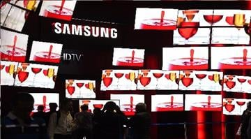 A display of  S' UHD 4K TV from Samsung are seen at the Consumer Electronics Show, January 8, 2015, in Las Vegas, Nevada.  AFP PHOTO / Robyn BECK        (Photo credit should read ROBYN BECK/AFP/Getty Images) By ROBYN BECK