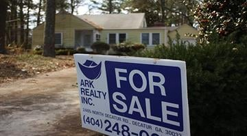 A for sale sign sits on the front lawn of a home in the Atlanta, Georgia area. By Stephanie Baumer