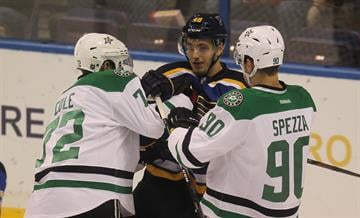 Dallas Stars Erik Cole (L) and Jason Spezza grab the sweater of St. Louis Blues Petteri Lindbohm in the first period at the Scottrade Center in St. Louis on December 27, 2014. UPI/Bill Greenblatt By BILL GREENBLATT