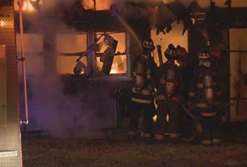 Fire crews in Cahokia work to put out a fire that started just before midnight on Thursday. By KMOV