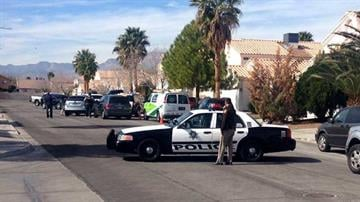 Police block off a road about a block from the home of Tammy Meyers, on Feb. 19, 2015, as they arrest someone in connection with her shooting By Stephanie Baumer