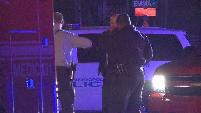 Police investigate the scene of a shooting and vehicle crash in North St. Louis.