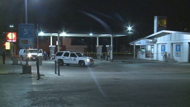 Police investigate the scene where a man was shot and then carjacked overnight in North St. Louis.