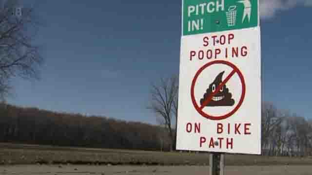 A sign posted on a Hampton, Illinois bike path Credit: WQAD