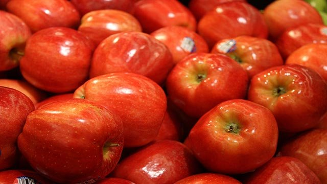 Apples are on display at a grocery store in Atlanta, Georgia. Red fruits like an apple can be some of the healthiest foods to eat. The deeper the color, the more effective they are at helping turn off obesity genes. Studies have shown they can help regula
