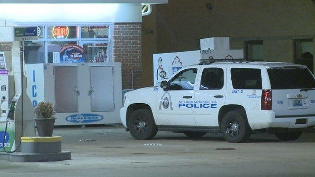 St. Louis police investigate the scene of an armed robbery at a BP gas station.