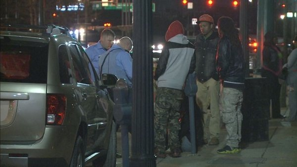 Authorities speak with witnesses after a one-year-old child was shot on March 17