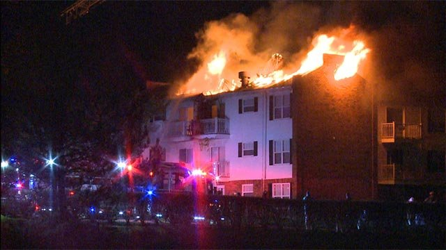 The fire began around 2:30 a.m. on the balcony of the Oxford Hills Apartments, officials say.