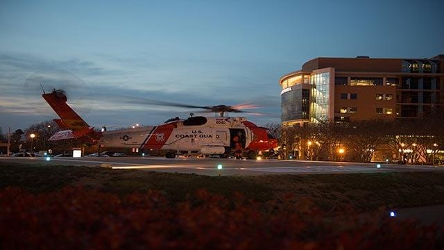 (PO2 Walter Shinn/US Coast Guard)A Coast Guard MH-60 Jayhawk helicopter crew lands at Sentara Norfolk General Hospital in Norfolk, Va., Thursday, April 2, 2015, after medevacing Louis Jordan