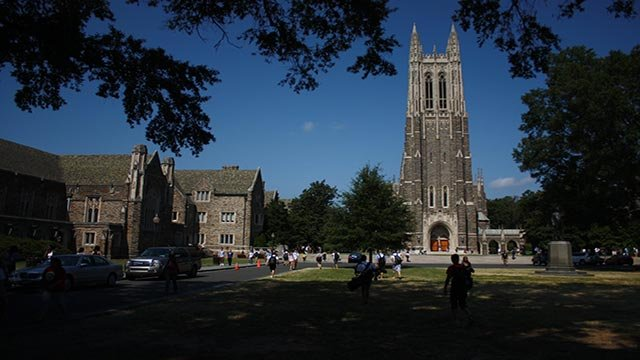"""(Jay Schexnyder/CNN) Views from the main """"quad"""" showing chapel tower, students walking past gothic buildings and across shady lawns"""