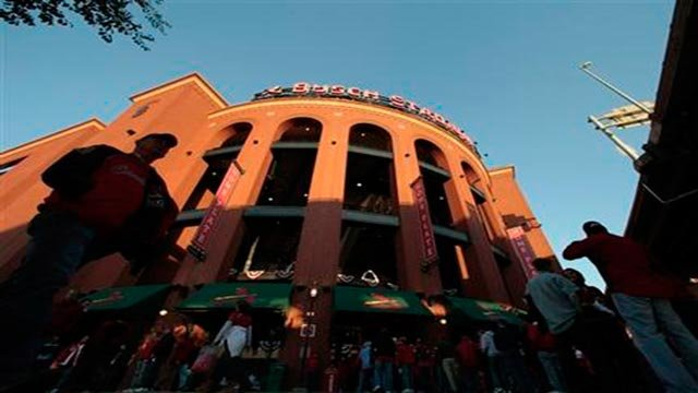 (AP) Fans make their way to Busch Stadium for Game 7 of baseball's World Series between the St. Louis Cardinals and the Texas Rangers Friday, Oct. 28, 2011, in St. Louis. (AP Photo/Charlie Riedel)