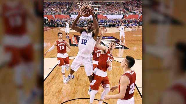 Duke's Justise Winslow (12) drives to the basket over Wisconsin's Sam Dekker (15) and Bronson Koenig, right, during the first half of the NCAA Final Four college basketball tournament championship game Monday, April 6, 2015, in Indianapolis. (Source: AP P