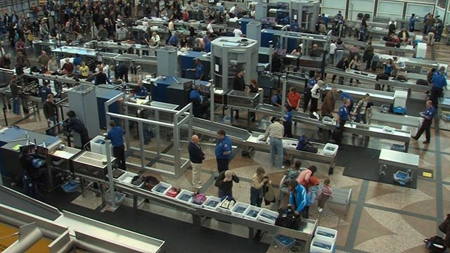 (CNN) Travelers queue at a TSA security checkpoint prior to flying.