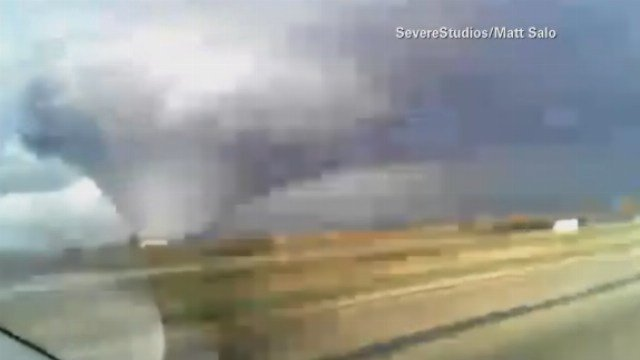 The large tornado was recorded as it neared New Milford, IL. (Source: SevereStudios/Matt Salo/CNN)  Read more: http://www.kctv5.com/story/28757305/authorities-1-dead-7-hurt-in-illinois-town-after-tornado#ixzz3WtuIsdfI