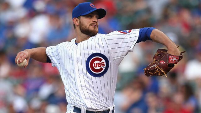 Justin Grimm #52 of the Chicago Cubs pitches against the Washington Nationals at Wrigley Field on June 27, 2014. (Photo by Jonathan Daniel/Getty Images)