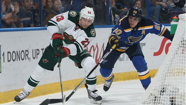 ST. LOUIS, MO - APRIL 11: Alexander Steen #20 of the St. Louis Blues and Sean Bergenheim #23 of the Minnesota Wild battle for the puck on April 11, 2015 at the Scottrade Center in St. Louis, Missouri. (Photo by Holly Jo Swan/NHLI via Getty Images)
