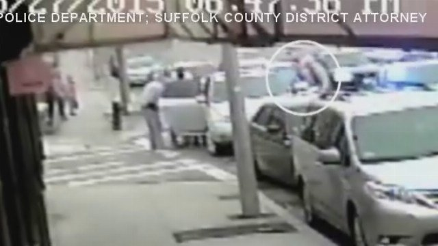 Video shows a Boston officer being shot by a suspect.