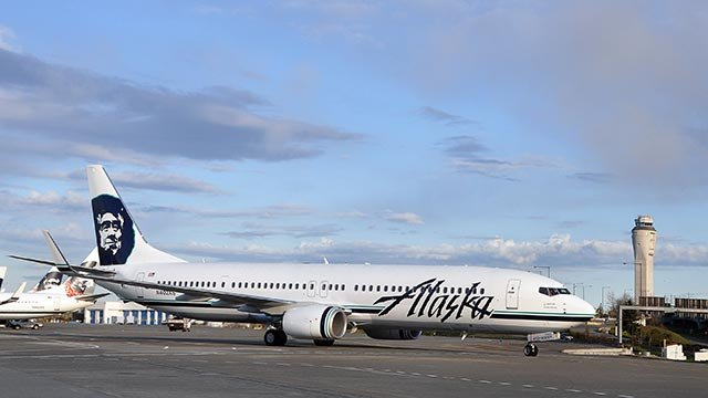 (Alaska Airlines) publicity photograph from Alaska Airlines showing a Boeing 737-900ER aircraft on the ground.