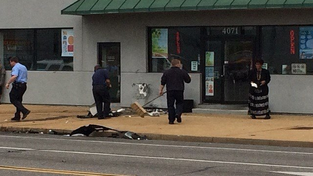 At least four people were injured after a two-vehicle collision sent one car into a building Tuesday.