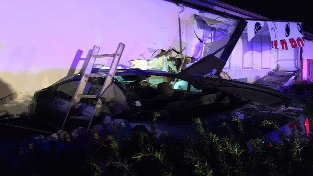 A car crashed into a local St. Charles bar overnight, leaving a hole in the business and sending the driver to the hospital.