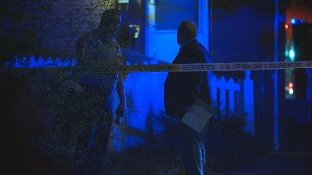 Police investigate the scene of a shooting in St. Louis on Wednesday.