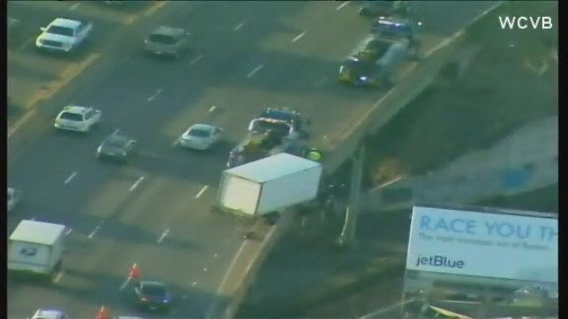 Box truck accident causes traffic, train delays around I-93 in Boston.