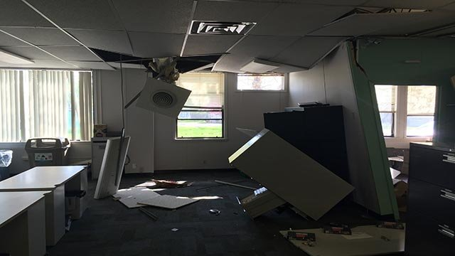 An elderly woman crashed her car into the Charter building in Maryville, Illinois Friday morning.