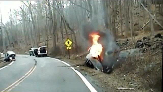 The overturned convertible was smoldering, when police pulled up to it on a New Jersey roadway.