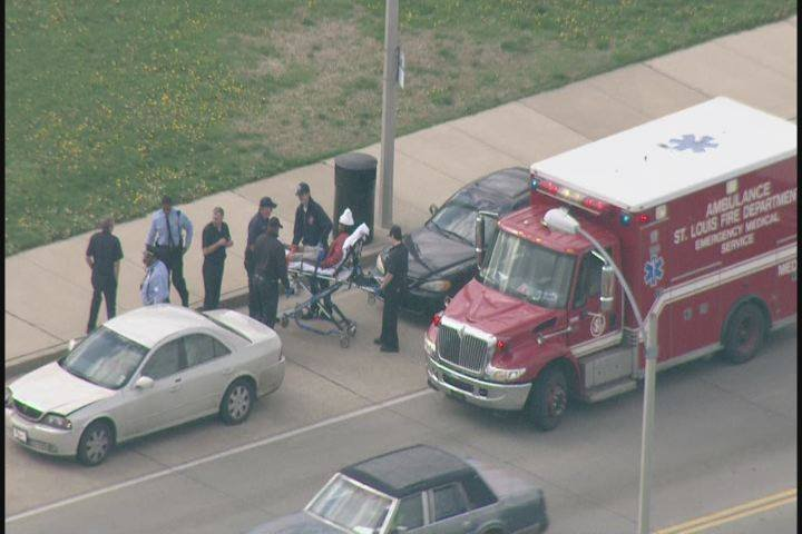A victim is transported by ambulance after being shot in St. Louis's Baden neighborhood on April 20.